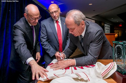"""Gary P. Saltzman, President of B'nai B'rith International, and Daniel S. Mariaschin, Executive Vice President of B'nai B'rith International honor Boston Red Sox President & CEO Emeretus Larry Lucchino during a B'Nai B'Rith event at Fenway Park in Boston, Massachusetts Tuesday, November 17, 2015."""
