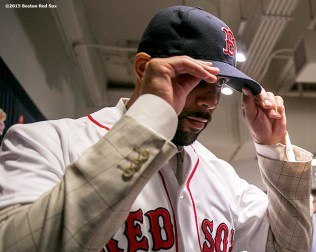 """Pitcher David Price adjusts his cap after addressing the media during a press conference after agreeing to a seven year contract with the Boston Red Sox at Fenway Park in Boston, Massachusetts Friday, December 4, 2015."""