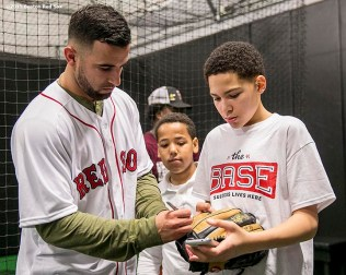 """Boston Red Sox infielder Deven Marrero signs autographs at the Base during the Holiday Caravan in Boston, Massachusetts Friday, December 10, 2015."""