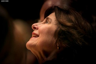 """Anne Hawley looks on during a musical performance during a farewell celebration for Anne Hawley at the Isabella Stewart Gardner Museum in Boston, Massachusetts Tuesday, December 15, 2015."""