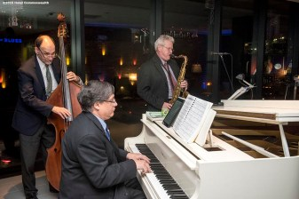 """A jazz trio plays during the Hotel Commonwealth Sparkle & Glow grand opening party at Hotel Commonwealth in Boston, Massachusetts Thursday, January 21, 2016."""