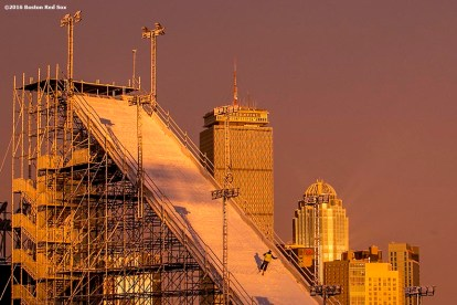 """A worker is shown while the sun sets as construction continues on the Polartec Big Air ski and snowboard ramp at Fenway Park in Boston, Massachusetts Friday, February 5, 2016."""