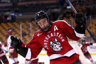 BOSTON, MA - FEBRUARY 08: Mike McMurtry #7 of Northeastern University reacts after scoring a goal against Harvard University during the first period of the Beanpot Tournament consolation game at TD Garden on February 8, 2016 in Boston, Massachusetts. (Photo by Billie Weiss/Getty Images) *** Local Caption *** Mike McMurtry