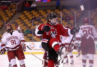 BOSTON, MA - FEBRUARY 08: Adam Gaudette #8 of Northeastern University reacts after scoring a goal against Harvard University during the first period of the Beanpot Tournament consolation game at TD Garden on February 8, 2016 in Boston, Massachusetts. (Photo by Billie Weiss/Getty Images) *** Local Caption *** Adam Gaudette