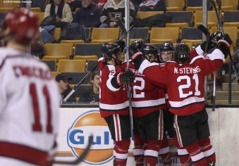 BOSTON, MA - FEBRUARY 08: Adam Gaudette #8 of Northeastern University reacts with teammates after scoring a goal against Harvard University during the third period of the Beanpot Tournament consolation game at TD Garden on February 8, 2016 in Boston, Massachusetts. (Photo by Billie Weiss/Getty Images) *** Local Caption *** Adam Gaudette