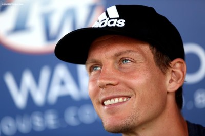 """Tomas Berdych signs autographs at the Tennis Warehouse booth during the 2016 BNP Paribas Open at the Indian Wells Tennis Garden in Indian Wells, California Sunday, March 13, 2016."""