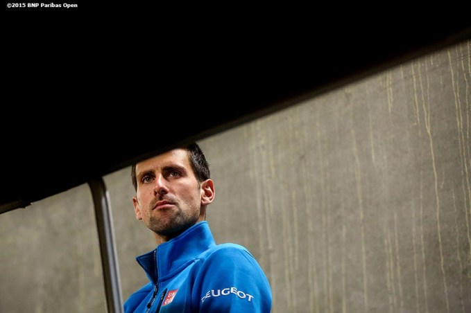 """Novak Djokovic warms up in the tunnel before a match against Bjorn Fratangelo during the 2016 BNP Paribas Open at the Indian Wells Tennis Garden in Indian Wells, California Sunday, March 13, 2016."""