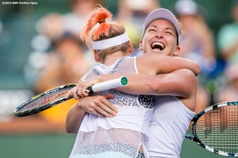 """Bethanie Mattek-Sands and Coco Vandeweghe react after defeating Julia Goerges and Karolina Pliskova in the women's doubles final during the 2016 BNP Paribas Open at the Indian Wells Tennis Garden in Indian Wells, California Saturday, March 19, 2016."""