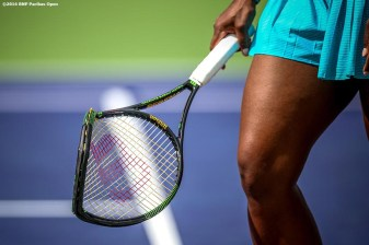 """Serena Williams breaks her racquet in action against Victoria Azarenka in the women's finals match during the 2016 BNP Paribas Open at the Indian Wells Tennis Garden in Indian Wells, California Sunday, March 20, 2016."""