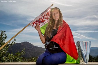 """Victoria Azarenka poses for a photograph with the trophy and flag of Belarus after defeating Serena Williams in the women's finals match during the 2016 BNP Paribas Open at the Indian Wells Tennis Garden in Indian Wells, California Sunday, March 20, 2016."""