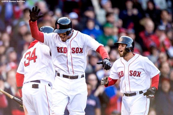 BOSTON, MA - APRIL 16: Xander Bogaerts #2 of the Boston Red Sox reacts alongside David Ortiz #34 and Dustin Pedroia #15 after hitting a three run home run during the third inning of a game against the Toronto Blue Jays on April 16, 2016 at Fenway Park in Boston, Massachusetts . (Photo by Billie Weiss/Boston Red Sox/Getty Images) *** Local Caption *** Xander Bogaerts; Dustin Pedroia, David Ortiz