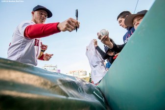 BOSTON, MA - APRIL 20: Brock Holt # 12 of the Boston Red Sox signs autographs before a game against the Tampa Bay Rays on April 20, 2016 at Fenway Park in Boston, Massachusetts . (Photo by Billie Weiss/Boston Red Sox/Getty Images) *** Local Caption *** Brock Holt