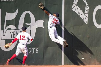 BOSTON, MA - APRIL 21: Jackie Bradley Jr. #25 of the Boston Red Sox attempts to catch a fly ball off the Green Monster as Brock Holt #12 looks on during the eighth inning of a game against the Tampa Bay Rays on April 21, 2016 at Fenway Park in Boston, Massachusetts . (Photo by Billie Weiss/Boston Red Sox/Getty Images) *** Local Caption *** Jackie Bradley Jr.; Brock Holt