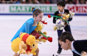 BOSTON, MA - APRIL 1: Sweepers clear the ice of stuffed animals during Day 5 of the ISU World Figure Skating Championships 2016 at TD Garden on April 1, 2016 in Boston, Massachusetts. (Photo by Billie Weiss - ISU/ISU via Getty Images) *** Local Caption ***