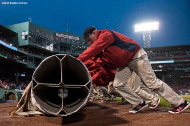 BOSTON, MA - MAY 1: Members of the grounds crew roll a tarp before a game between the Boston Red Sox and the New York Yankees on May 1, 2016 at Fenway Park in Boston, Massachusetts. (Photo by Billie Weiss/Boston Red Sox/Getty Images) *** Local Caption ***
