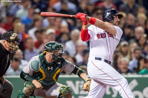 BOSTON, MA - MAY 10: Travis Shaw #47 of the Boston Red Sox hits a three run home run during the fifth inning of a game against the Oakland Athletics on May 10, 2016 at Fenway Park in Boston, Massachusetts. (Photo by Billie Weiss/Boston Red Sox/Getty Images) *** Local Caption *** Travis Shaw