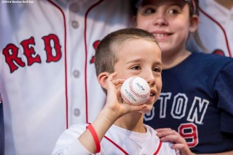BOSTON, MA - MAY 10: A young fan poses after throwing out the ceremonial first pitch before a game between the Boston Red Sox and the Oakland Athletics on May 10, 2016 at Fenway Park in Boston, Massachusetts. (Photo by Billie Weiss/Boston Red Sox/Getty Images) *** Local Caption ***