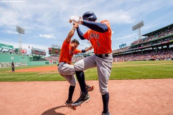 BOSTON, MA - MAY 14: Carlos Correa #1 of the Houston Astros reacts with Jose Altuve #27 after hitting a solo home run during the first inning of a game against the Boston Red Sox on May 14, 2016 at Fenway Park in Boston, Massachusetts. (Photo by Billie Weiss/Boston Red Sox/Getty Images) *** Local Caption *** Carlos Correa; Jose Altuve