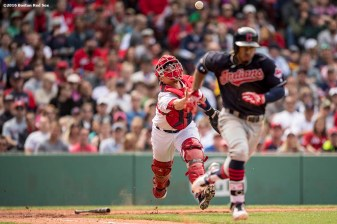BOSTON, MA - MAY 22: Christian Vazquez #7 of the Boston Red Sox catches a ground ball as Francisco Lindor #12 of the Cleveland Indians runs to first base during the fifth inning of a game on May 22, 2016 at Fenway Park in Boston, Massachusetts. (Photo by Billie Weiss/Boston Red Sox/Getty Images) *** Local Caption *** Christian Vazquez; Francisco Lindor