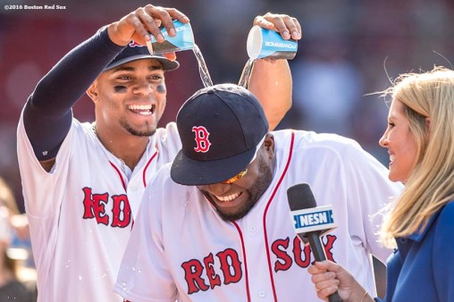 BOSTON, MA - MAY 22: Xander Bogaerts #2 gives David Ortiz #34 of the Boston Red Sox a Powerade shower after a game against the Cleveland Indians on May 22, 2016 at Fenway Park in Boston, Massachusetts. (Photo by Billie Weiss/Boston Red Sox/Getty Images) *** Local Caption *** David Ortiz; Xander Bogaerts