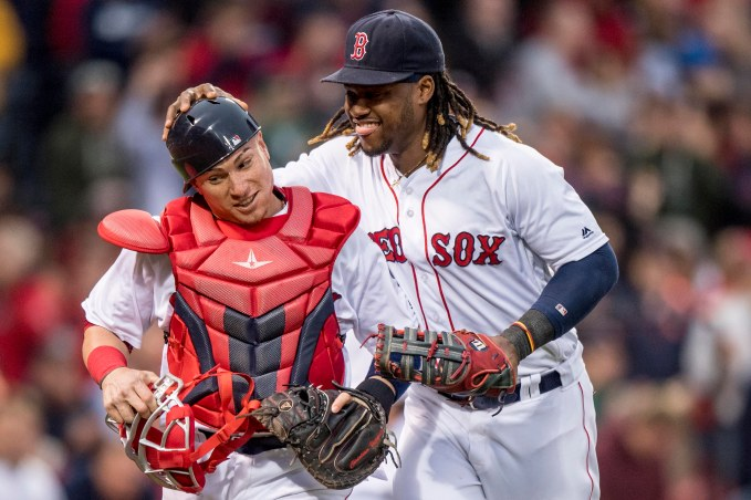 BOSTON, MA - MAY 24: Hanley Ramirez #13 reacts with Christian Vazquez #7 of the Boston Red Sox during the second inning of a game against the Colorado Rockies on May 24, 2016 at Fenway Park in Boston, Massachusetts. (Photo by Billie Weiss/Boston Red Sox/Getty Images) *** Local Caption *** Hanley Ramirez; Christian Vazquez