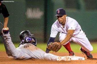 BOSTON, MA - MAY 25: Xander Bogaerts #2 of the Boston Red Sox tags out Carlos Gonzalez #5 as he slides into second base attempting to reach safely on a double during the eighth inning of a game against the Colorado Rockies on May 25, 2016 at Fenway Park in Boston, Massachusetts. (Photo by Billie Weiss/Boston Red Sox/Getty Images) *** Local Caption *** Xander Bogaerts; Carlos Gonzalez
