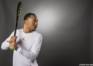 """""""Boston Red Sox outfielder Mookie Betts poses for a photograph for Axe Bat at Fenway Park in Boston, Massachusetts Wednesday, May 25, 2016."""""""