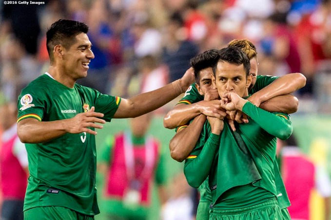 FOXBOROUGH, MASSACHUSETTS - JUNE 10: Jhasmani Campos of Bolivia reacts with teammates after scoring a goal during a group D match between Chile and Bolivia at Gillette Stadium as part of Copa America Centenario US 2016 on June 10, 2016 in Foxborough, Massachusetts, US. (Photo by Billie Weiss/LatinContent/Getty Images) *** Local Caption *** Jhasmani Campos