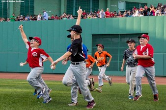 BOSTON, MA - JUNE 15: Little leaguers take the field before a game between the Boston Red Sox and the Baltimore Orioles on June 15, 2016 at Fenway Park in Boston, Massachusetts. (Photo by Billie Weiss/Boston Red Sox/Getty Images) *** Local Caption ***