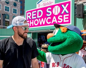 June 15, 2016, Boston, MA: Boston Red Sox pitcher Matt Barnes is greeted by mascot Wally the Green Monster during the unveiling of the Red Sox Showcase Mobile Truck powered by T-Mobile at Faneuil Hall in Boston, Massachusetts Wednesday, June 15, 2016. (Photo by Billie Weiss/Boston Red Sox)