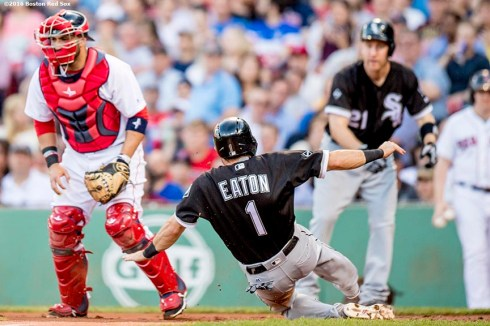 BOSTON, MA - JUNE 21: Adam Eaton #1 of the Chicago White Sox slides as he scores during the first inning of a game against the Boston Red Sox on June21, 2016 at Fenway Park in Boston, Massachusetts. (Photo by Billie Weiss/Boston Red Sox/Getty Images) *** Local Caption *** Adam Eaton