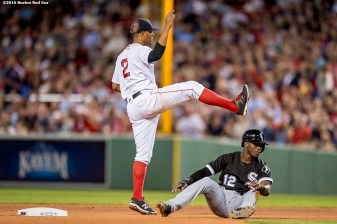 BOSTON, MA - JUNE 21: Xander Bogaerts #2 of the Boston Red Sox throws to first base in an attempted double play as Tim Anderson #12 of the Chicago White Sox slides during the eighth inning of a game on June21, 2016 at Fenway Park in Boston, Massachusetts. (Photo by Billie Weiss/Boston Red Sox/Getty Images) *** Local Caption *** Xander Bogaerts, Tim Anderson