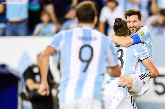 FOXBORO, MASSACHUSETTS - JUNE 18: Éver Lamela of Argentina reacts with Lionel Messi after scoring a goal during a Quarterfinal match between Argentina and Venezuela at Gillette Stadium as part of Copa America Centenario US 2016 on June 18, 2016 in Foxboro, Massachusetts, US. (Photo by Billie Weiss/LatinContent/Getty Images)