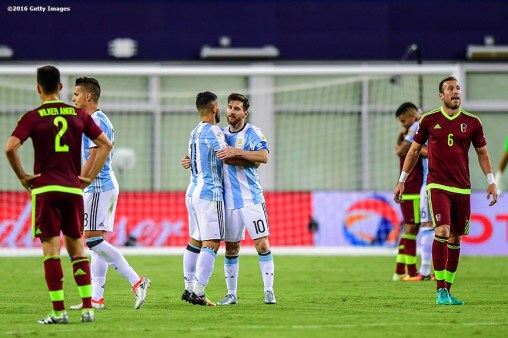 FOXBORO, MASSACHUSETTS - JUNE 18: Lionel Messi reacts with Sergio Aguero after a Quarterfinal match between Argentina and Venezuela at Gillette Stadium as part of Copa America Centenario US 2016 on June 18, 2016 in Foxboro, Massachusetts, US. (Photo by Billie Weiss/LatinContent/Getty Images)