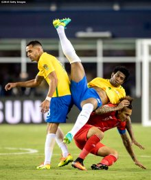 FOXBORO, MASSACHUSETTS - JUNE 12: Paolo Guerrero of Peru and Gil of Brazil collide during a group B match between Brazil and Peru at Gillette Stadium as part of Copa America Centenario US 2016 on June 12, 2016 in Foxboro, Massachusetts, US. (Photo by Billie Weiss/LatinContent/Getty Images)