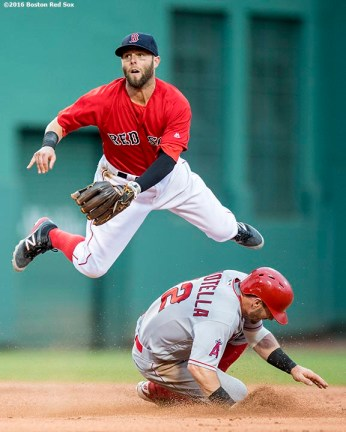 BOSTON, MA - JULY 1: Dustin Pedroia #15 of the Boston Red Sox turns a double play as Johnny Giovotella #12 of the Los Angeles Angels of Anaheim slides during the second inning of a game on July1, 2016 at Fenway Park in Boston, Massachusetts. (Photo by Billie Weiss/Boston Red Sox/Getty Images) *** Local Caption *** Dustin Pedroia; Johnny Giovotella