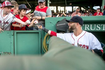BOSTON, MA - JULY 5: Dustin Pedroia #15 of the Boston Red Sox signs autographs before a game against theTexas Rangers on July 5, 2016 at Fenway Park in Boston, Massachusetts. (Photo by Billie Weiss/Boston Red Sox/Getty Images) *** Local Caption *** Dustin Pedroia