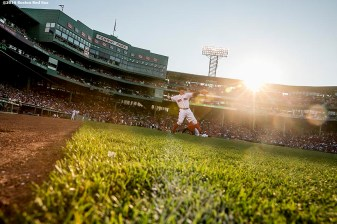BOSTON, MA - JULY 5: Brock Holt #12 of the Boston Red Sox warms up before a game against theTexas Rangers on July 5, 2016 at Fenway Park in Boston, Massachusetts. (Photo by Billie Weiss/Boston Red Sox/Getty Images) *** Local Caption *** Brock Holt