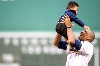 BOSTON, MA - JULY 8: Newly acquired Boston Celtics player Al Horford reacts with his son Ean after throwing out the ceremonial first pitch before a game between the Boston Red Sox and the Tampa Bay Rays on July 8, 2016 at Fenway Park in Boston, Massachusetts. (Photo by Billie Weiss/Boston Red Sox/Getty Images) *** Local Caption *** Al Horford