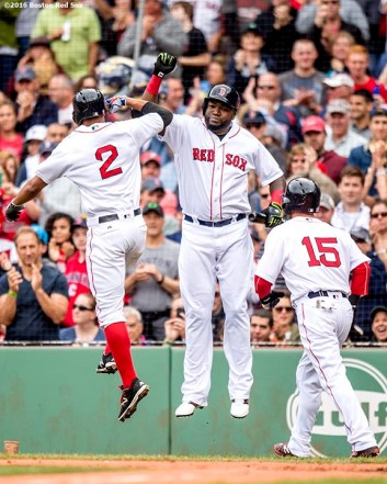 BOSTON, MA - JULY 8: Xander Bogaerts #2 of the Boston Red Sox high fives David Ortiz #15 after hitting a two run home run during the fourth inning of a game against the Tampa Bay Rays on July 9, 2016 at Fenway Park in Boston, Massachusetts. (Photo by Billie Weiss/Boston Red Sox/Getty Images) *** Local Caption *** Xander Bogaerts; David Ortiz