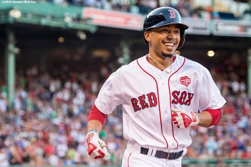 BOSTON, MA - JULY 21: Mookie Betts #50 of the Boston Red Sox reacts after hitting a solo home run during the first inning of a game against the Minnesota Twins on July 21, 2016 at Fenway Park in Boston, Massachusetts. (Photo by Billie Weiss/Boston Red Sox/Getty Images) *** Local Caption *** Mookie Betts