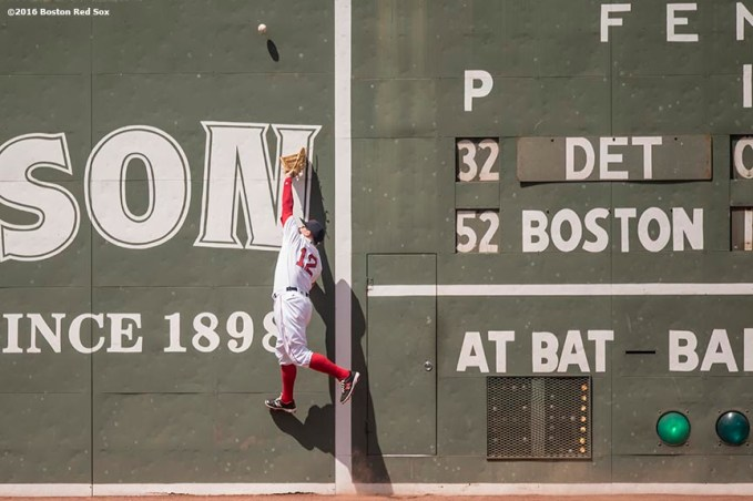 BOSTON, MA - JULY 27: Brock Holt #12 of the Boston Red Sox reaches to catch a fly ball during the third inning of a game against the Detroit Tigers on July 27, 2016 at Fenway Park in Boston, Massachusetts. (Photo by Billie Weiss/Boston Red Sox/Getty Images) *** Local Caption *** Brock Holt