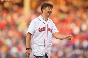 BOSTON, MA - AUGUST 11: Former Boston Red Sox pitcher Hideki Okajima reacts after throwing out a ceremonial first pitch before a game against the New York Yankees on August 11, 2016 at Fenway Park in Boston, Massachusetts. (Photo by Billie Weiss/Boston Red Sox/Getty Images) *** Local Caption *** Hideki Okajima