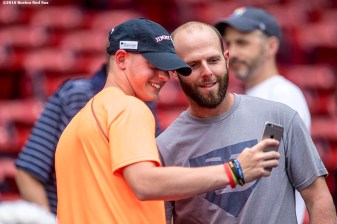 BOSTON, MA - AUGUST 12: Dustin Pedroia #15 of the Boston Red Sox poses for a selfie photograph with a Jimmy Fund patient before a game against the Arizona Diamondbacks on August 12, 2016 at Fenway Park in Boston, Massachusetts. (Photo by Billie Weiss/Boston Red Sox/Getty Images) *** Local Caption *** Dustin Pedroia