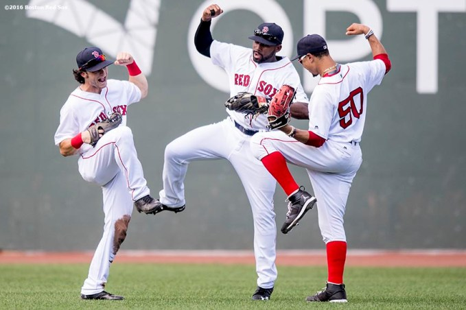 BOSTON, MA - AUGUST 14: Andrew Benintendi #40, Jackie Bradley Jr. #25, and Mookie Betts #50 of the Boston Red Sox celebrate a victory against the Arizona Diamondbacks on August 14, 2016 at Fenway Park in Boston, Massachusetts. (Photo by Billie Weiss/Boston Red Sox/Getty Images) *** Local Caption *** Andrew Benintendi; Jackie Bradley Jr.; Mookie Betts