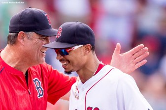 BOSTON, MA - AUGUST 14: Mookie Betts #50 of the Boston Red Sox and Manager John Farrell celebrate a victory against the Arizona Diamondbacks on August 14, 2016 at Fenway Park in Boston, Massachusetts. (Photo by Billie Weiss/Boston Red Sox/Getty Images) *** Local Caption *** John Farrell; Mookie Betts