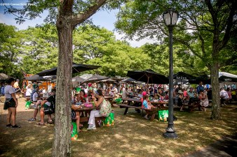 August 21, 2016, New Haven, Connecticut: Fans enjoy lunch in the food court during Day 3 of the 2016 Connecticut Open at the Yale University Tennis Center on Sunday, August 21, 2016 in New Haven, Connecticut. (Photo by Billie Weiss/Connecticut Open)