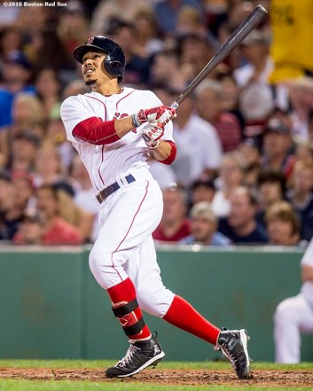 BOSTON, MA - AUGUST 27: Mookie Betts #50 of the Boston Red Sox hits a solo home run during the fifth inning of a game against the Kansas City Royals on August 27, 2016 at Fenway Park in Boston, Massachusetts. (Photo by Billie Weiss/Boston Red Sox/Getty Images) *** Local Caption *** Mookie Betts
