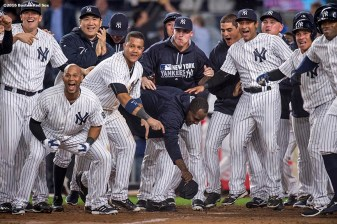 NEW YORK, NY - SEPTEMBER 28: Members of the New York Yankees react as Mark Teixeira #25 of the New York Yankees hits a walk off grand slam home run during the ninth inning of a game against the Boston Red Sox on September 28, 2016 at Yankee Stadium in the Bronx borough of New York City. (Photo by Billie Weiss/Boston Red Sox/Getty Images) *** Local Caption *** Mark Teixeira