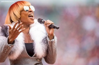 BOSTON, MA - OCTOBER 2: Mary J. Blige sings the National Anthem during an honorary retirement ceremony for David Ortiz #34 of the Boston Red Sox in his final regular season game at Fenway Park against the Toronto Blue Jays on October 2, 2016 at Fenway Park in Boston, Massachusetts. (Photo by Billie Weiss/Boston Red Sox/Getty Images) *** Local Caption *** David Ortiz; Mary J. Blige